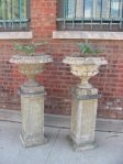 Pair of French Cast Stone Urns on Pedestals
