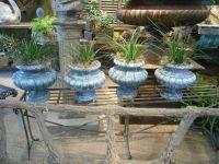 Set of four French enameled cast iron urns
